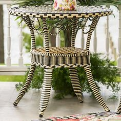 Courtyard Outdoor Cafe Table: Take wicker up a notch with our Courtyard Outdoor Cafe Table. Made of weather-ready, handwoven resin in a timeless geometric pattern of black, white, and goldenrod, wrapped on a durable PVC frame. A versatile palette, and the perfect complement to your Courtly Check® dinnerware.