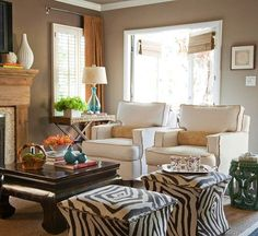 layout inspiration--two chairs, table or lam near window, two ottomans in front of coffee