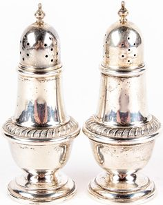 """Lot 26 in the 11.17.15 online & live auction! A beautiful set of vintage sterling silver salt and pepper shakers. The simple yet elegant design features a pedestal base with tapered stem, rope design pattern mid stem, and screw on lids with finial tops. Each is marked, """"Alvin Sterling S238"""". Items have some light tarnish but no dents or dings. Each measures 4.5"""" tall. #Home #Kitchen #POGAuctions"""