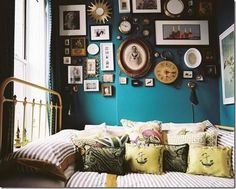 love the colour with the ecclectic mix of frames on the wall,