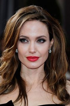 Fair skin looks flawless with statement red lippy and dark eyes a la Miss Jolie.