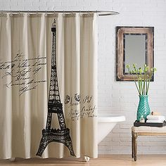 Bring a touch of beautiful Parisian style to your bathroom decor with the Anthology Paris Shower Curtain. Boasting chic charm, this cotton shower curtain features a bold Eiffel tower print with vintage-style script, set against a neutral-toned background.