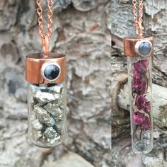 Two new steampunk-esque glass vial pendents. Filled with pyrite and flowers