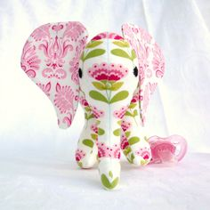 Elephant toy with pacifier tail and sound, pink and white. Made to order. on Etsy, $50.79