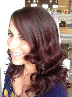By Carla Makowski. red highlights to dark violet brown hair for awesome dimension.