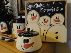 Paint up any lidded container for a frosty the snowman, this looks like an old fondue pot.