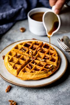 Freezer friendly healthy pumpkin waffles with cozy spices + a touch of maple syrup. These fluffy waffles will be your go-to fall breakfast. #breakfast #pumpkin #waffles #fall #healthyrecipes