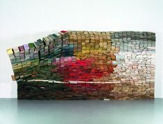 """""""enclosed content chatting away in the colour of invisibility"""" - by Anouk Kruithof.  Composed of 4,000 books."""