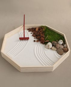 editational desktop Zen garden with moss gets a modern spin with geometric elements.