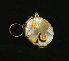 Pretty little Evans vintage 1920's Art Deco gold and silver tone compact purse with colorful enamel, gold chain and finger ring.