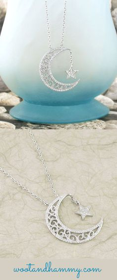 A sparkly star dangles from a fancy crescent moon...sterling silver necklace.