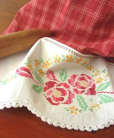 I love this idea.  Etsy seller TwoGirlsLaughing takes vintage pillowcases, cuts off the beautiful embroidery and sews them on to tea towels.