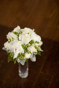 white wedding bouquet with green hypericum berries | Photo: William Walker Photography