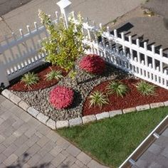 LANDSCAPE DESIGN & PLANTINGS ALONG WITH A NEW CUSTOM VINYL FENCE | Yelp