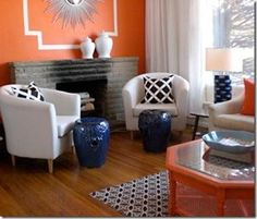 Navy and orange living room. Great colors, like wall detail and coordinating coffee table.