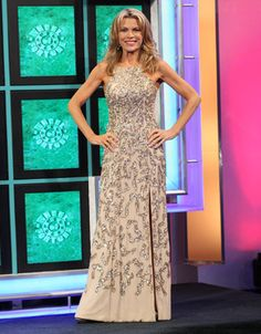 FAVIANA: Champagne chiffon gown w/gold beads & sequins in abstract pattern, halter bodice, sleeveless, low back w/three straps across, flared hemline  | Vanna White's dresses | Wheel of Fortune
