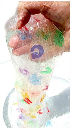 eye spy alphabet slime: mix 2 cups clear glue with 2 cups very warm water, add letters. separately mix 1 tsp borax with 1 1/3 cups very warm water. mix liquids together. if too sticky, add another teaspoon of water and a small amount borax.