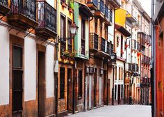 9. Spend an afternoon in the old town of Oviedo — the capital of Asturias, a principality in north-west Spain — and admire the mismatched houses that line a typical street.