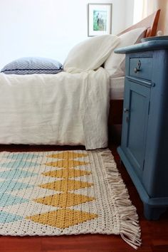 This is the rug I'll crochet for our room. Using grey, a light teal, bright…