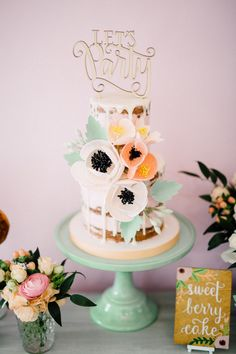 The prettiest fondant floral topped cake: Read More on SMP: http://www.stylemepretty.com/living/2016/05/25/this-baby-shower-puts-the-cutest-twist-on-the-phrase-bun-in-the-oven/