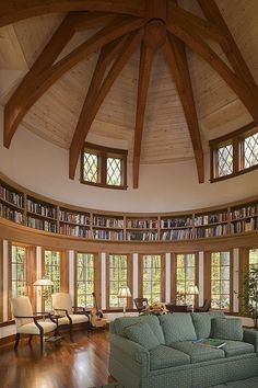 What a wonderful office and library this is! Love the high ceilings and wooden beams mixed with lots of natural light