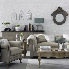 Create a living room with real wow-factor with soft grey tones and classic furniture. Here a damask print wallpaper and silvery fabrics add to the sense of elegance in the room. Keep accessories to a minimum, choosing items that complement the scheme