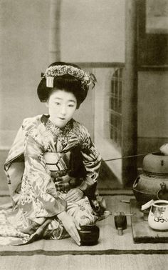 "Osaka maiko Yachiyo II, performing a hakobi-temae, tea ceremony, 1910s. Hakobi means ""to carry"", temae means ""the ritual preparation of tea""."