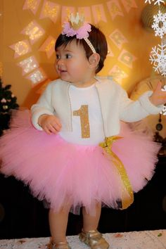 Items similar to Pink and gold first birthday tutu on Etsy Pink and gold first birthday tutu by LeighannsAngels on Etsy 1st Birthday Outfit Girl, Minnie Mouse Birthday Outfit, 1st Birthday Photoshoot, Baby Girl First Birthday, Pink Birthday, Mermaid Birthday, Princess Birthday, Princess Tutu, Cake Smash Outfit Girl