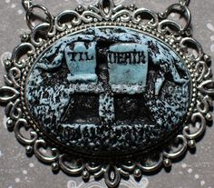 Gothic Lolita Cameo Necklace  Creepy Cute Gothic by VonErickson, $18.00 Von Erickson Laboratories ,purveyors of all sorts of original gothic spooky jewelry . It's what all the graveyard groupies are wearing this season!