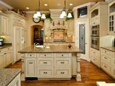 http://new.fatare.com/how-to-paint-your-kitchen-cabinets-antique-white/
