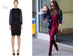 Victoria Beckham Jil Sander - JFK Victoria wore a Jil Sander maroon dress with navy satin sleeves, which she styled with her favourite Giuseppe Zanotti knee-length boots.
