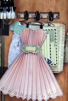 THIS DRESS HANGS IN A MINITURE STORE MADE OF PAPER: merchant of marvels, paper dresses  // LOTS OF INSPIRATION FOR DOING TINY WORK
