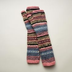 BLOOMSBURY FINGERLESS GLOVES -- Warm and chic, our colorful alpaca gloves keep hands cozy while leaving fingers free to create their next masterpiece. Imported. One size fits most adults.