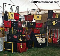Purse display at an outdoor craft show - GREAT use of a PVC frame. Are those PVC shelves?
