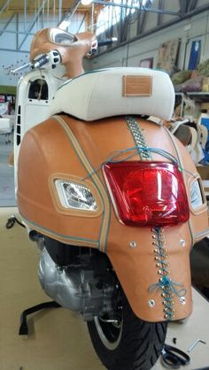 ...and leather covered Vespa!  Handmade at www.bottegaconticelli.it