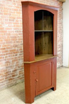 farmhouse Corner Cabinet in Barn red and golden brown interior
