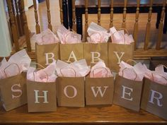 Inside each bag is something for the baby and it starts with the letter on the bag. Each guest has to guess what's inside.