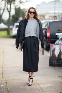 J.J. Martin. Oversized outfit, cool top with geometric seams, large pleaded calf length skirt, short haired fur jacket. Paris Fashion Week, Street style.