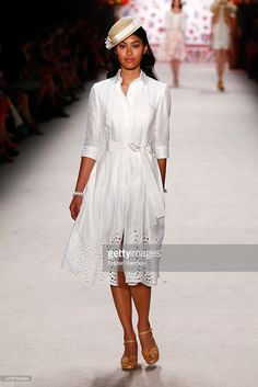 A model walks the runway at the Lena Hoschek show during the Mercedes-Benz Fashion Week Berlin Spring/Summer 2016 at Brandenburg Gate on July 7, 2015 in Berlin, Germany.