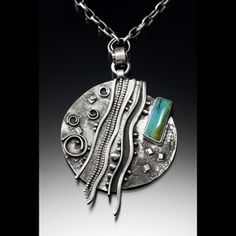 We're happy to have Delias Thompson back this year, come see her stunning jewelry at the festival!
