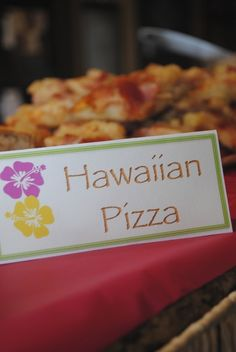 Can buy inexpensive pizza and add your own ingredients buy already with toppings. Cut into small squares for luau themed party.