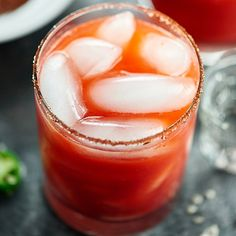 Strawberry Jalapeno Margarita - a spicy/sweet margarita on the rocks with a chili/salt rim!