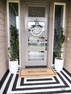 Modern Spring Porch Decor - Floor Plants - Ideas of Floor Plants - Get your porch ready for spring! Taryn shares her tips for decorating a front porch and reveals her modern spring porch decor! The black and white outdoor rug makes such a statement! Doors, House Design, House With Porch, Patio Decor, Front Door, Front Porch Decorating, Entryway Decor, Spring Porch Decor, Porch Design