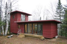 The McGlasson weeHouse boasts a rooftop deck, gorgeous forest views, and a price far below $200,000 — talk about a dream home!