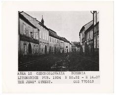 'The Jews Street' A Cobblestone street with shops, a sign for Reims Wine.  Litomerice, circa 1934.