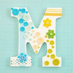 DIY Monogram wall art http://www.bhg.com would look cute with buttons and rhinestones or glitter :)