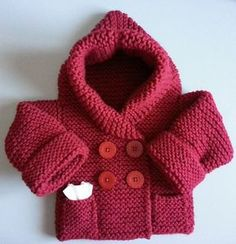 Free Knitting Pattern for Baby Hooded Jacket - Baby hoodie cardigan sweater in garter stitch with pockets. Sizes 3mo. – 6mo. Designed by Cecilia Creation. Aran weight yarn.