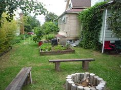 Home-made fire pit & benches....also our amazing hops & raised beds.