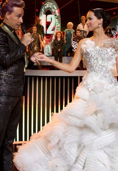 Catching Fire.. Is it weird that if I ever get married again I want a dress like that? Lol! Unless it's a Vegas wedding then no. Lol!!