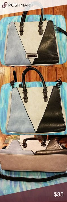 """Steve Madden Handbag Beautiful excellent condition: not a mark on the strap, the handles, or the bottom. The inside is just like brand new. It has a 20"""" adjustable crossbody strap and the plastic is still on the Steve Madden silver label on the front. The bag has two sections with two zippered areas inside and two open pockets. Size 11x9.5"""", 5"""" strap drop. The colors are light blue, gray, and black. Outside 100% polyurethane, Inside 100% polyester. Steve Madden Bags Crossbody Bags"""
